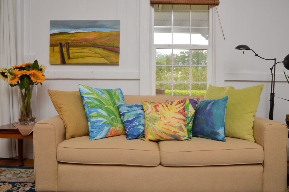 West Hawaii Today, at home on Hawai'i Island's article about the artist Mary Spears' home in Waimea. Plantation style, comfy livingroom.